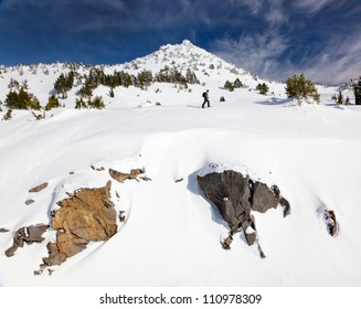 Hiker traveling across a winter slope