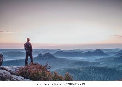Hiker traveling on hill peaks landscape. Sport, tourism and hiking concept.