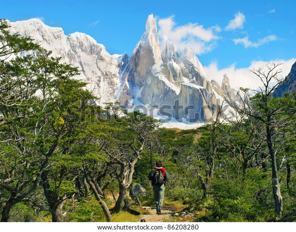 Hiker trekking in scenic landscape with Cerro Torre in the background in Los Glaciares National Park, Patagonia, Argentina, South America