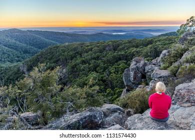 Hiker waiting for Sunrise in Mt Kaputar National Park