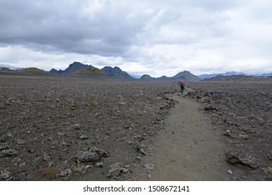Hiker walking on a trail, Iceland