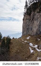Hiker walking towards the peak of Pedrafoca, spain pyrenees mountain.