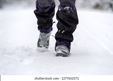 Hiker wearing a snow boots and gaiter at snowy winter country