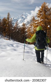 Hiker in a winter mountain landscape, Mont Blanc, Italy