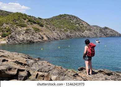 hiker woman in the Cap de Creus on the La Taballera beach, Costa Brava, Girona province, Catalonia,  Spain