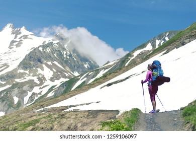 Hiker. Woman hiking smiling happy on trek with backpack during summer outdoors activity. Fresh joyful multiethnic Asian Caucasian female model walking in Yosemite National Park, California, USA