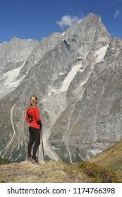 Hiker woman looking at mountain. Courmayeur