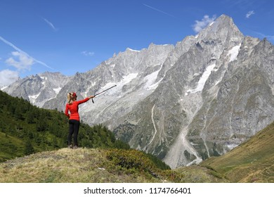 Hiker woman pointing the Grand Jorasses glacier