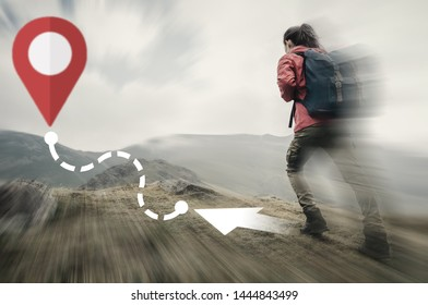 Hiker young woman going up on mountain to route with location GPS pin. Navigation concept. Image with moving fast and motion blur effect.