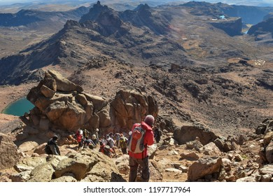 Hikers against the volcanic landscapes of Mount Kenya. August 29th 2015 at Mount Kenya National Park, Kenya