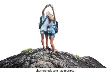 Hikers with backpack standing on the rock and taking selfie isolated on white background
