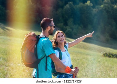 Hikers with backpacks walking at nature