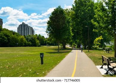 Hikers and bikers in Ann Street Park, London, Ontario.