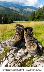 Hiker's boots on stone in mountains