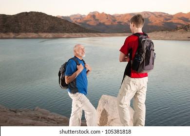 Hikers Conversing Along Lake Trail