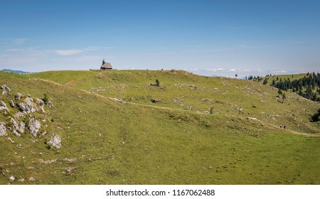 Hikers couple on the way  to the chapel of Snow Mary on Velika planina (Big Pasture Plateau)