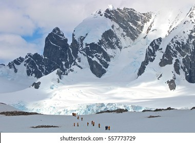 Hikers are dwarfed by mountains on the Antarctic Peninsula.