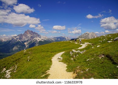 Hikers explore the  World War I trenches in the mountain top of Monte Piana,Dolomites Alps, Italy