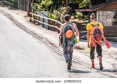 Hikers, extremal tourists walking to Meteora in Greece