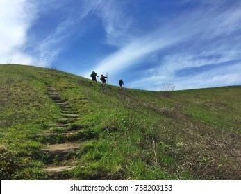 Hikers going up Max Patch in North Carolina