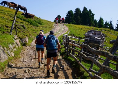 Hikers in the high country of the Dolomites Alps, Italy