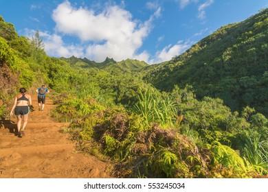 Hikers in Kalalau trail, Kauai Island, Hawaii