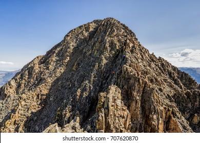 Hikers near the summit of Wilson Peak near Telluride, Colorado Rocky Mountains.