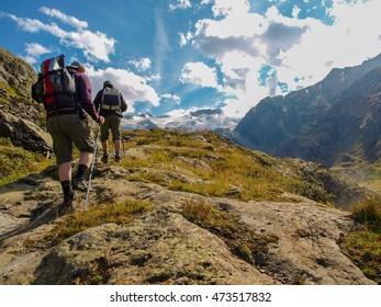 Hikers on alpine glacier mountains in switzerland