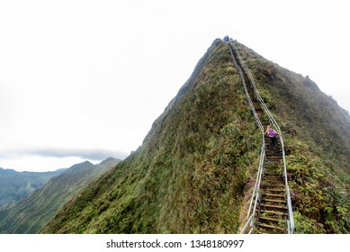 Hikers on the Haiku stairs, otherwise known as Stairway to Heaven, overlooking the windward side of Oahu, Hawaii and the H3 freeway