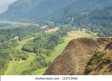 Hikers on a Mountain overlooking Columbia River Gorge