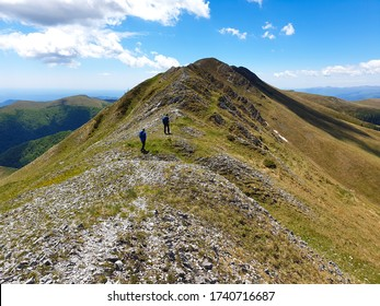 hikers on the Oslea Ridge, Valcan Mountains, Romania