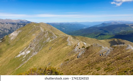 hikers on Oslea Ridge, Valcan Mountains, Romania, a beautiful spring day.