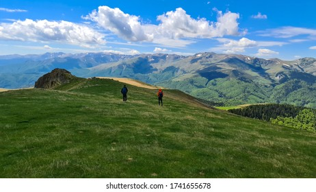 hikers on Oslea Ridge, Valcan Mountains, Romania