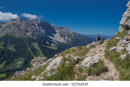 Hikers on Paolina Refuge-Roda de Vael Refuge hike-August 22, 2016: Old & young, single & groups are crowding trails 539 & 549, Catinaccio/Rosengarten mountain massif, Dolomites, South Tyrol, Italy