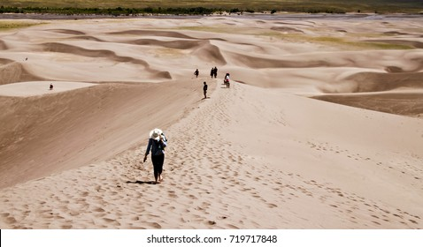 Hikers on Sand dune in Great sand dune national park colorado