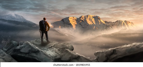 Hikers on a summit in a wintry mountain landscape