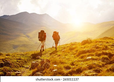 hikers on the trail in the Caucasian mountains. Trek to Kazbek mount