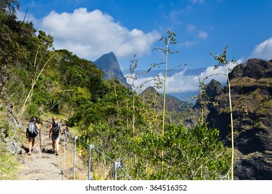 Hikers on a trail in the interior of Reunion Island in the cirque de Mafate