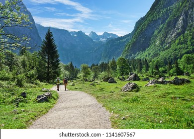 Hikers on the trail in the Scenic summer landscape view in the Alps, National park Berchtesgaden Land, Bavaria, Germany.