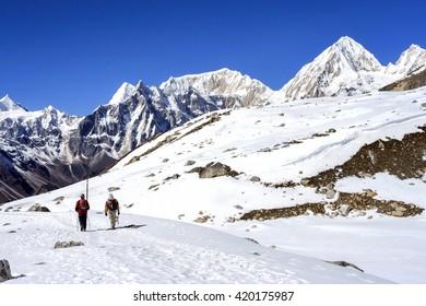 Hikers on the trek in Himalayas, Manaslu region, Nepal.