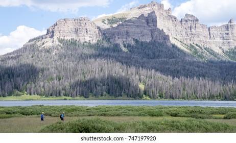 Hikers pass near Brooks Lake, Wyoming