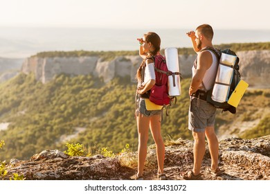 Hikers - people hiking, man looking at mountain nature landscape scenic with woman in background.