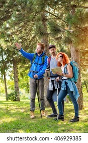Hikers show way through wood with arm