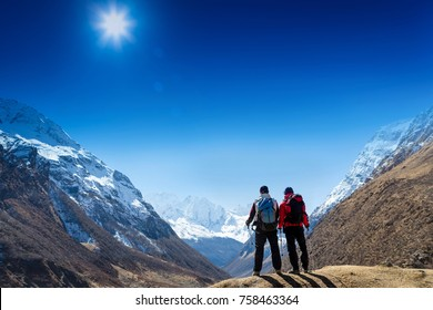 Hikers team on the mountain top. Sport and active life