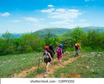 Hikers trekking in Crimea mountains