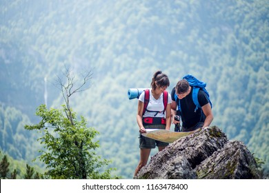 Hikers using map to navigate outdoor