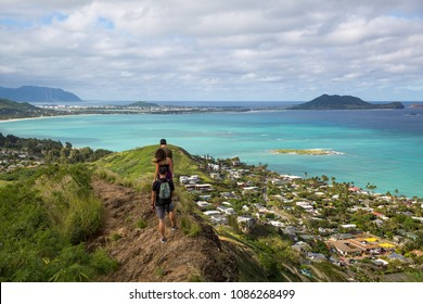 Hikers with the view of Lanikai from a top the Pillbox hiking trail Kailua Hawaii in December