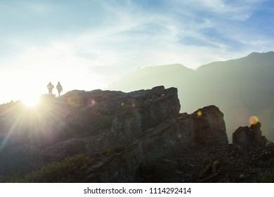 Hikers walk along the rim of the Ijen volcano crater on Java, Indonesia