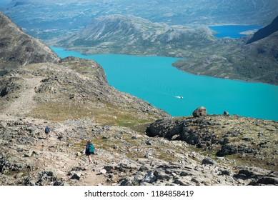 hikers walking on Besseggen ridge in Jotunheimen National Park, Norway