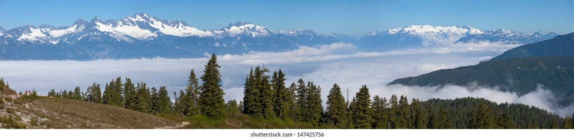 Hiking above Clouds in the Mountains